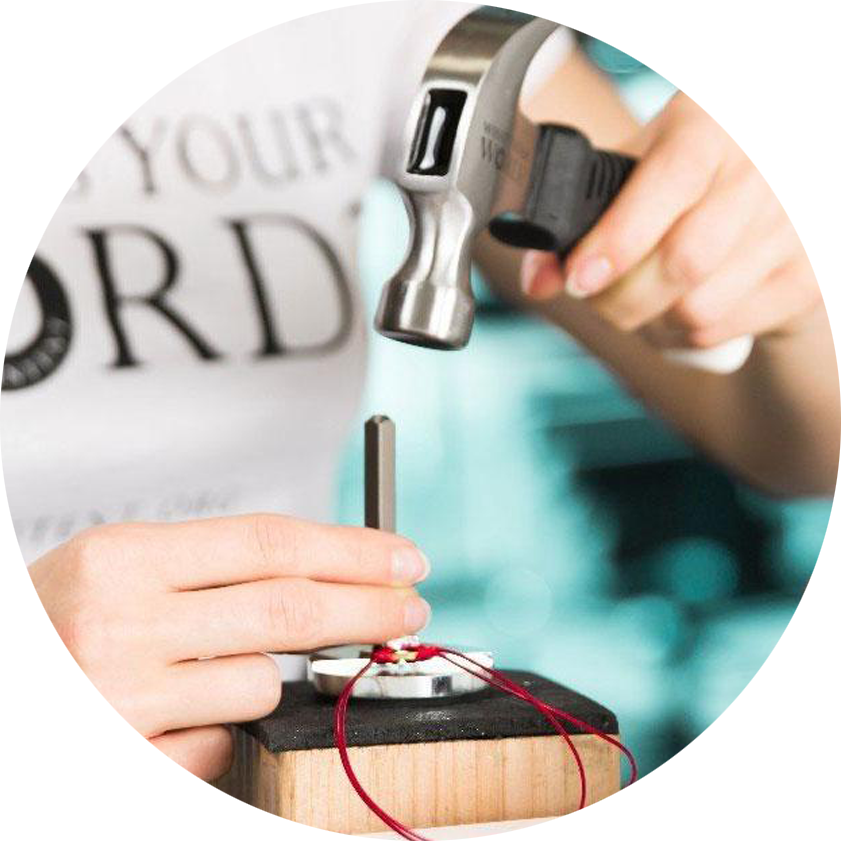 MyIntent Maker How-To Guide - MyIntent Maker stamping their bracelet using MyIntent tools