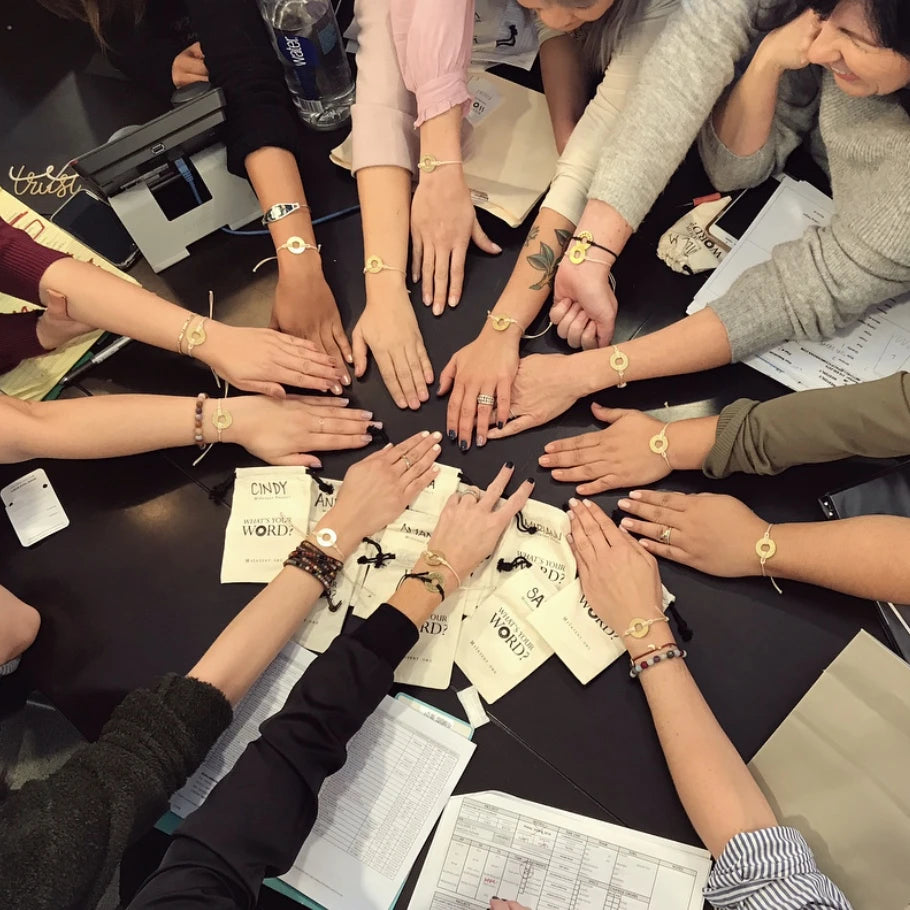 Group of people wearing their MyIntent Bracelets