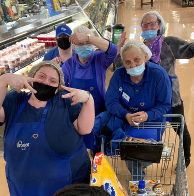 Grocery store workers wearing their MyIntent bracelets while proudly working on the front lines