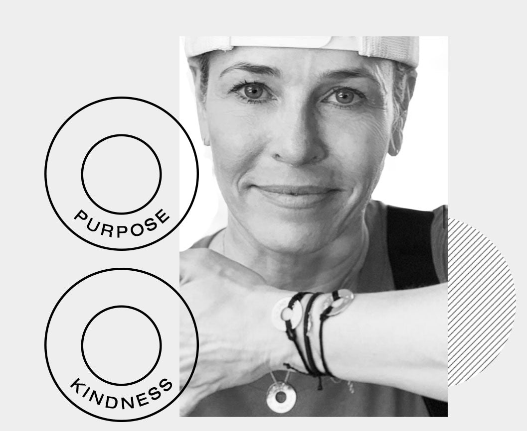 Chelsea Handler wearing her MyIntent bracelets with the words KINDNESS and BREATHE