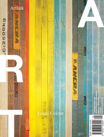 Magazine cover showing strips of wood in different colours from brown to yellow to blue.
