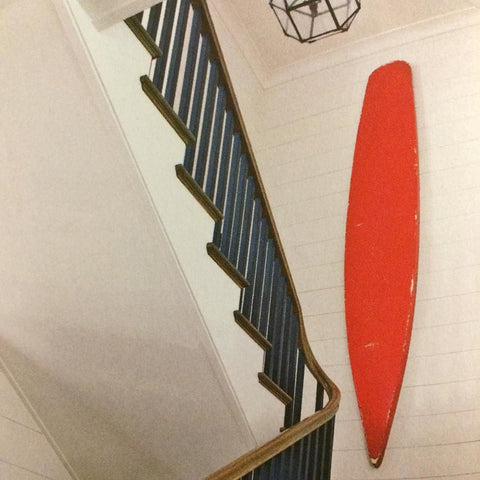 Red Surfboard on Wall Style Tip