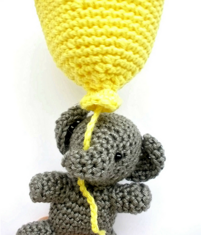 Crochet elephant with yellow balloon