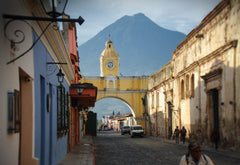 Guatemalan street with buildings and view of mountain
