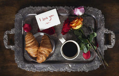 Valentine's breakfast tray with roses and coffee