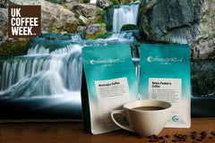 Packs of coffee and waterfall in background