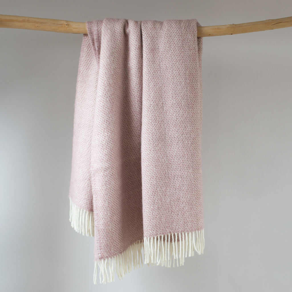 light pink woollen throw