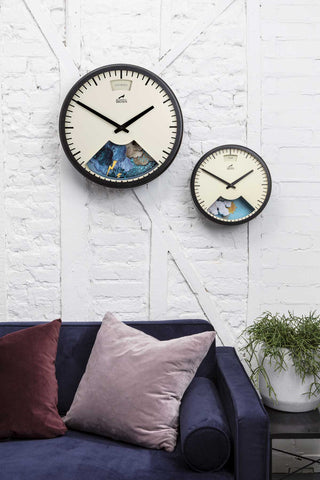 Small and Large Bramwell Brown Clocks on the wall