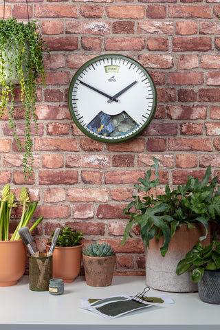 Spring Green Weather Clock showing Stormy