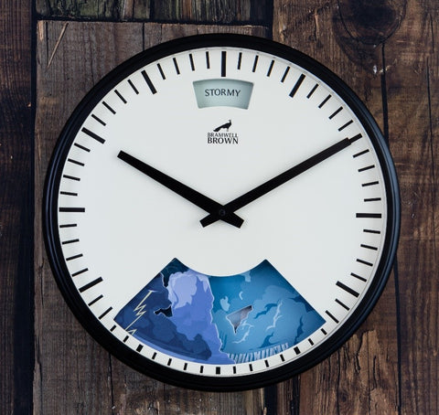 Black framed wall clock with weather artwork designed by Peter McDermott