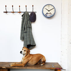 Beautiful wall clock with dog resting below