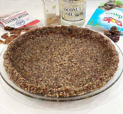 Pecan flour, dates and coconut oil make up this delicious crust for our Coconut Cream Pie Made with Chocolate Paleo Protein!