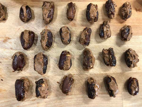 Dates filled with almond butter and Complete Paleo Protein powder.