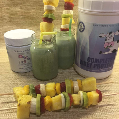 Tropical Greens Smoothie made with Complete Whey Protein, fresh fruit kabobs, coconut milk and Complete Organic Greens!