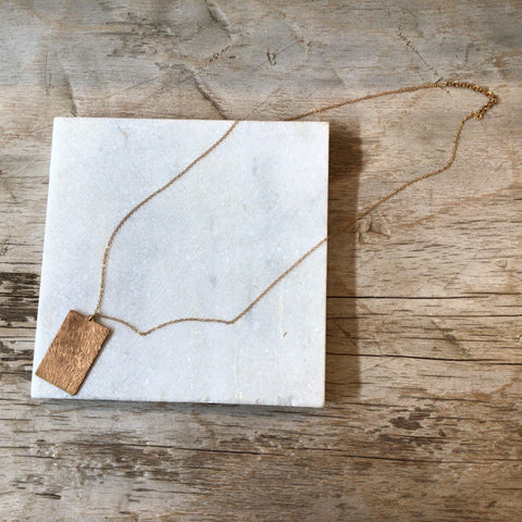 Gold necklace with rectangle pendent