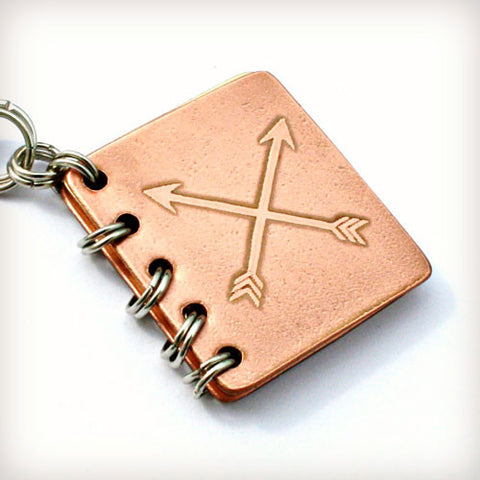 She Needed a Hero, So That's What She Became - Metal Book Pendant