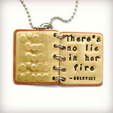 She's Mad But She's Magic, There's No Lie in Her Fire - Charles Bukowski quote - Metal Book Pendant
