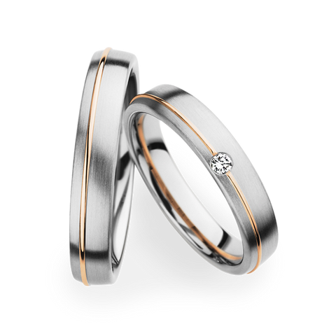 Christian Bauer platinum and rose gold matching wedding band set.
