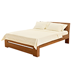 Bed with brown wooden bedframe and white sheets and pillows