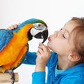 girl kissing parrot