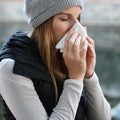woman suffering from winter allergies