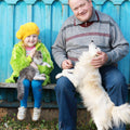 girl with grandfather and dog
