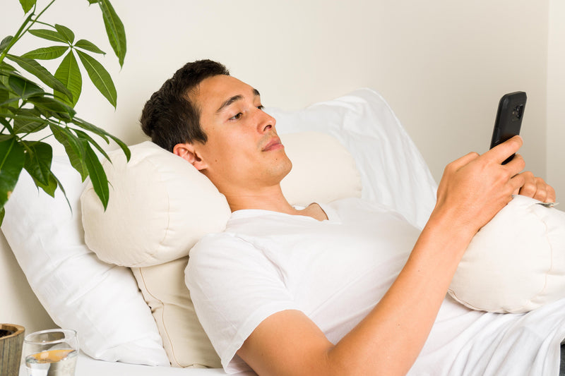 Man using ComfyComfy buckwheat hull ComfyNeck Pillow as neck support