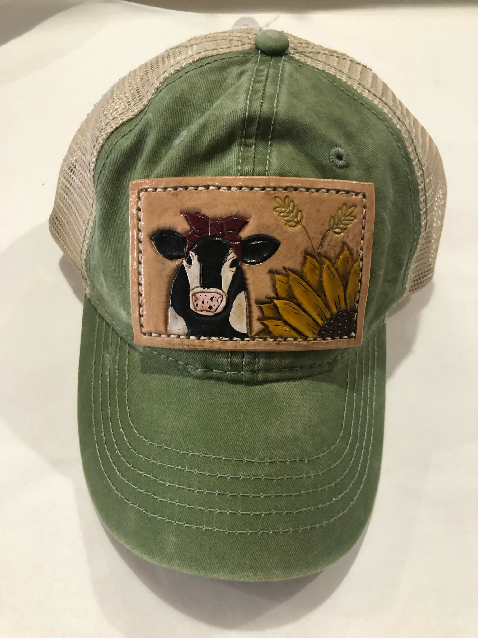 Green hat with cow