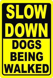 Slow Down Dogs Being Walked Sign