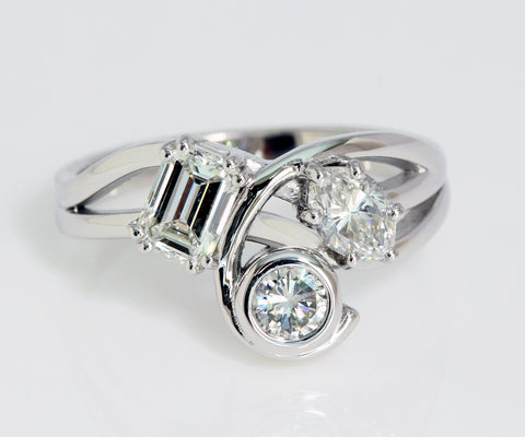Unique curved three diamond ring redesign