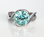 custom designed aquamarine and diamond bypass fashion ring