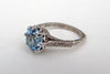 custom designed vintage engraved blue topaz engagement ring