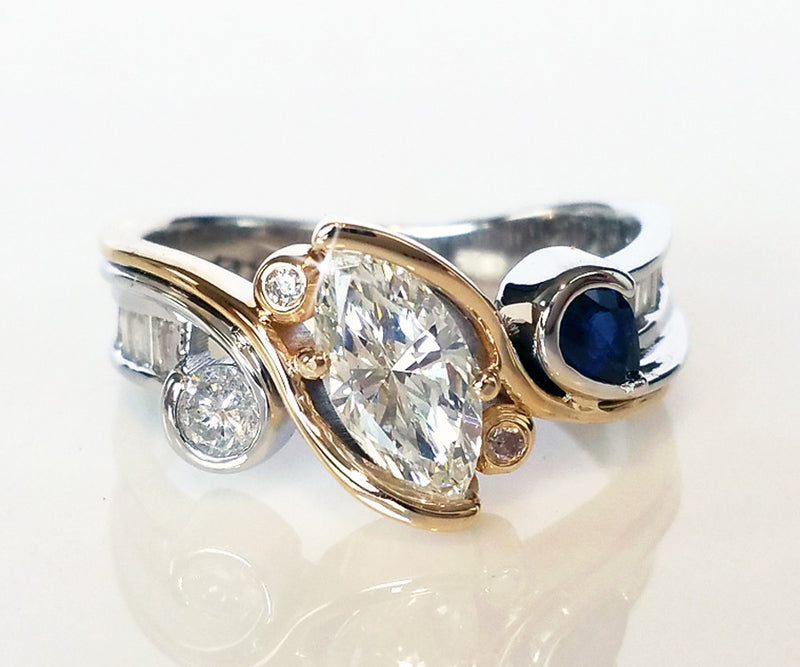 redesigned custom two tone marquise diamond blue sapphire ring