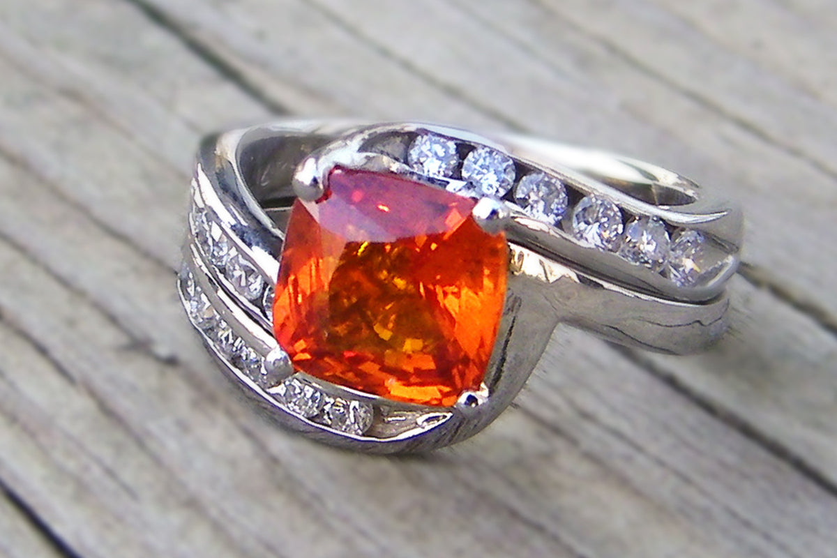cushion cut orange sapphire and diamond bypass wedding ring