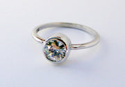 custom designed round diamond bezel engagement ring
