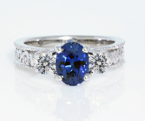 custom blue sapphire diamond swirl engagement ring