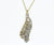 white and yellow gold diamond pave channel pendant