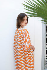 Monorails & Satellites UK Orange And White Bold Print Designer Beach Cover Up From Behind Close-Up