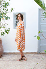 Monorails & Satellites UK Orange and White Print Sheer Knee-Length Designer Beach Cover Up From Side