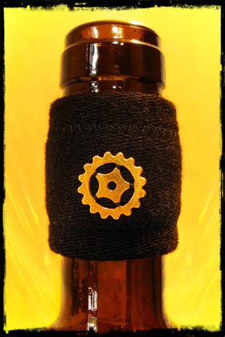 Wine band drip stopper with gold sprocket gear accessory