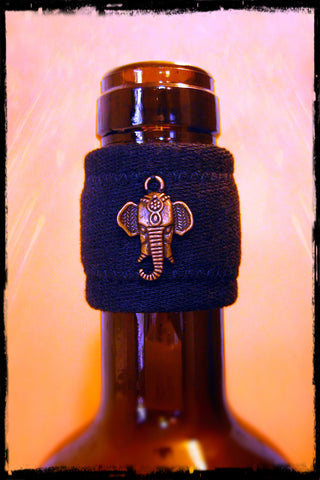 Wine accessory drip stopper band with brass elephant
