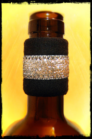 Wine drip stopper band for bottle with silver sparkle center