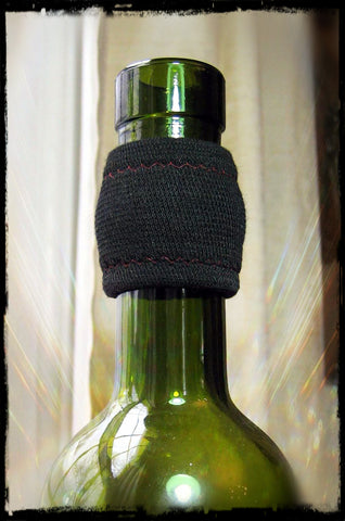 Wine Accessory Drip Stopper in classic black with red merlot stitching