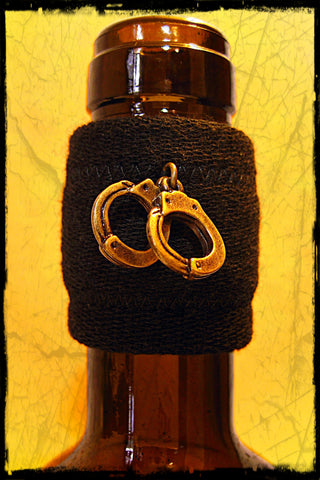 Wine accessory drip catcher gift with daring brass handcuffs