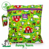 bold green sunny farm print wetbag for storing cloth nappies by Milovia