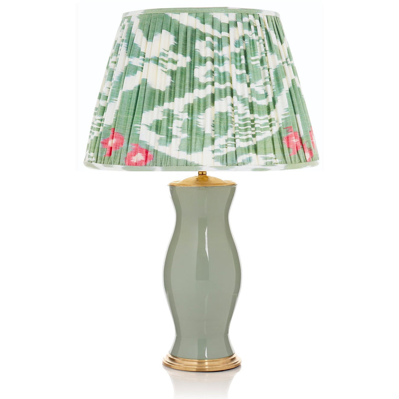 green glass lamp with green ikat lampshade