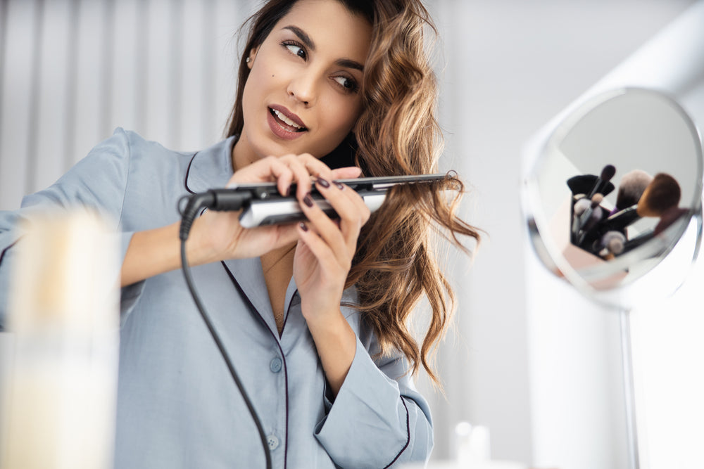 using heated curling irons damage
