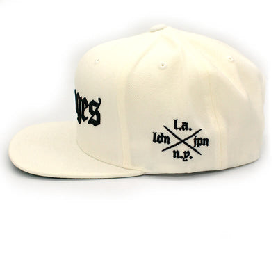 Savages Old English Snapback in white