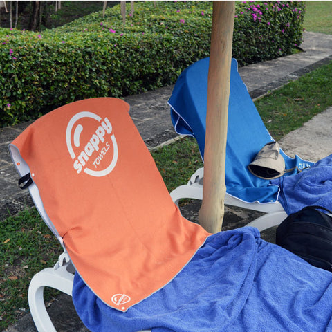 Claiming our spot by the pool with a bright Snappy Towels microfiber beach towel snapped to the back of the chair!