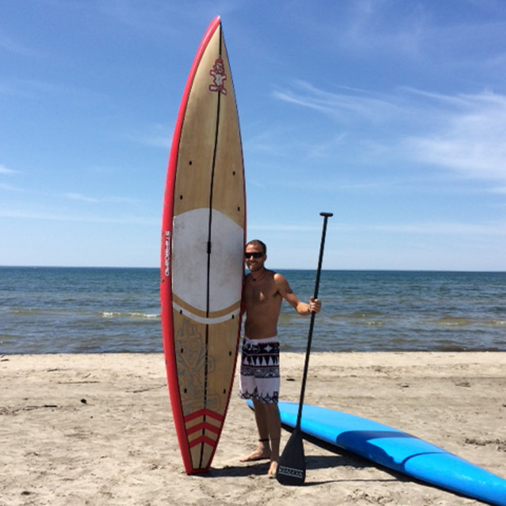 Stand up paddle boarder Brandon Lourie at the beach